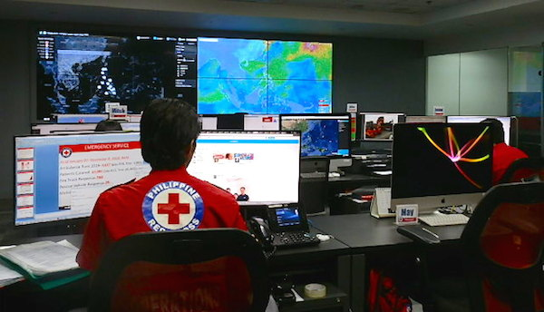 Control Room monitors incoming typhoon warnings as well as receives calls for assistance.