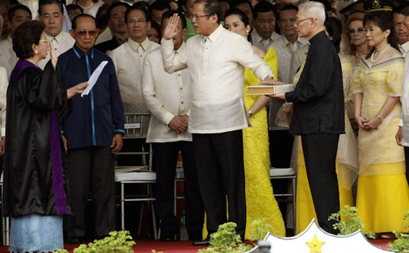 President Benigno Aquino III took his oath of office in 2010 before then-Associate Justice Conchita Carpio-Morales. Photo credit: By Rey S. Baniquet [Public domain], via Wikimedia Commons.